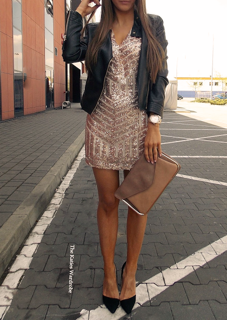 Black leather jacket heels, glossy silver short dress, bronze .