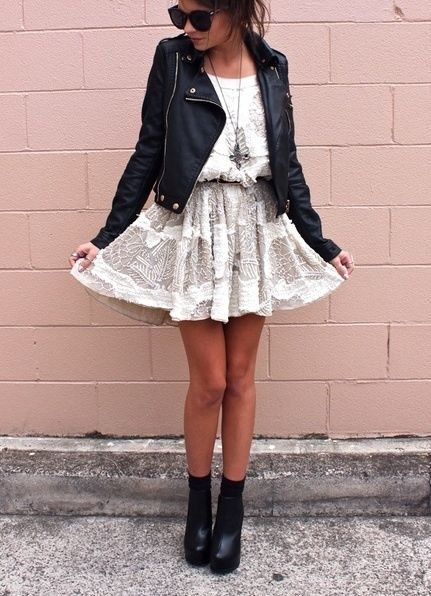 white lacey short dress, black leather jacket, black sunglasses .