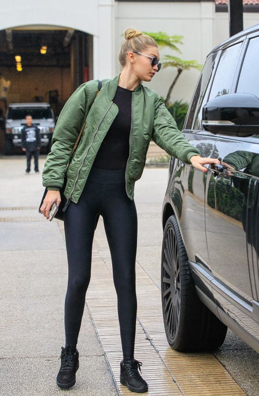 Gigi Hadid Green Jacket over total black sport outfit | Sporty .