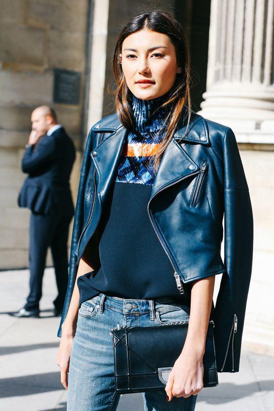 navy blue leather jacket + navy orange sleeveless turtleneck shirt .