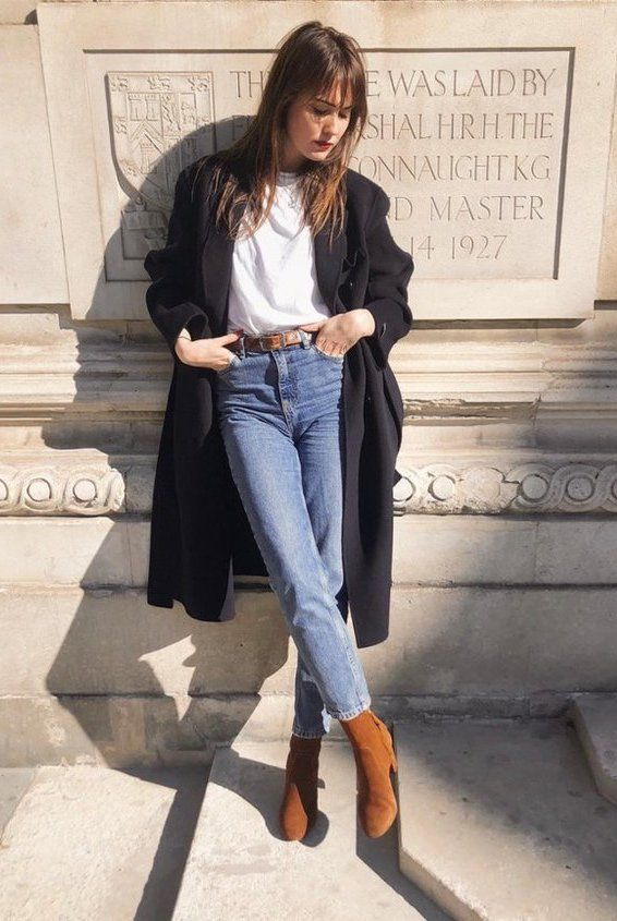 Jeans, white tee long black coat and brown ankle boots .