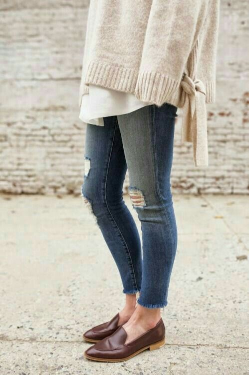Fall style. Sweater over tunic with distressed jeans and loafers .