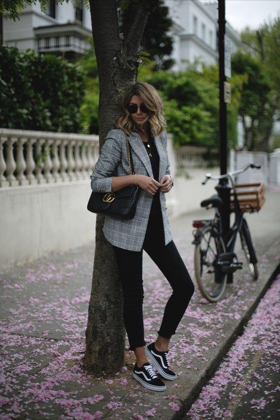 Emma Hill wears check Zara blazer, black t-shirt, black stepped .