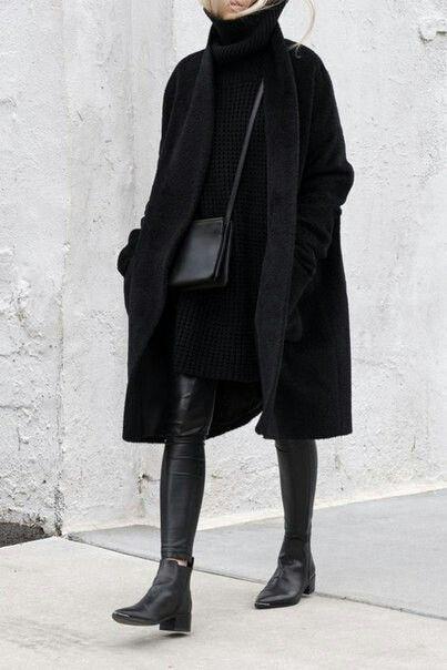 Black cashmere coat // black leather leggings // black boots .