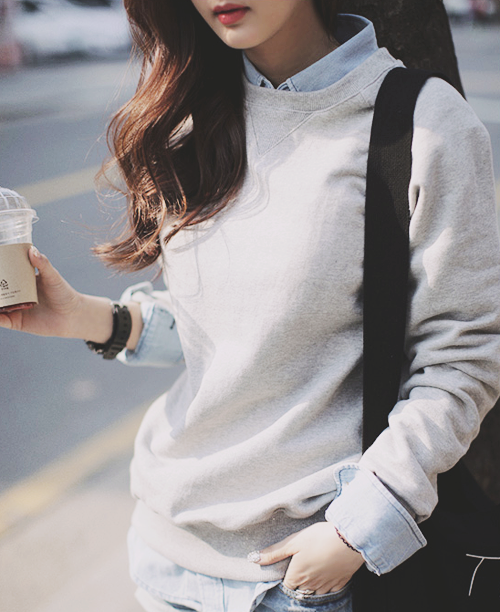 Sweatshirt with a collared/button up shirt underneath. (With .