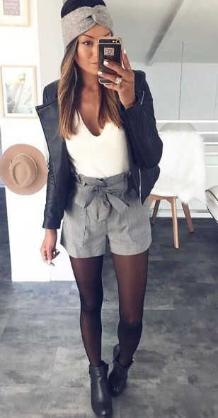 black tights plaid shorts black ankle boots white top black .