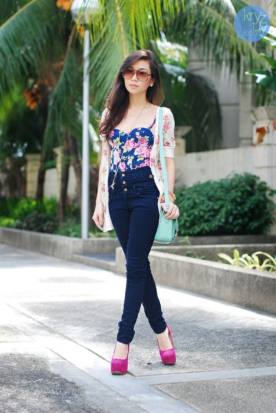 Blue Jeans with pink floral printed blue colored top dress idea .