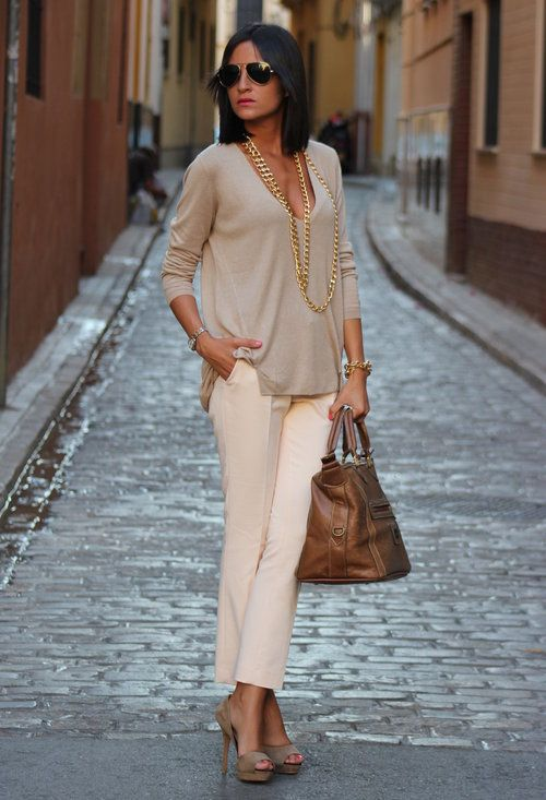 Classic beige blouse, cream pants, brown large handbag, and open .