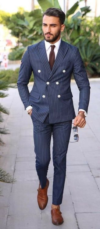 Classic style with a navy double breasted pinstripe suit white .