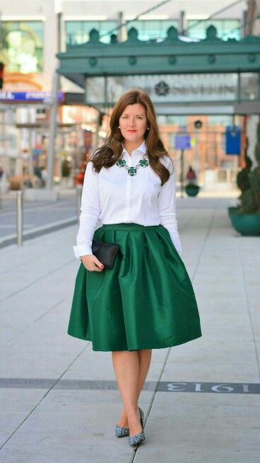white button up shirt and emerald green skirt and statement .