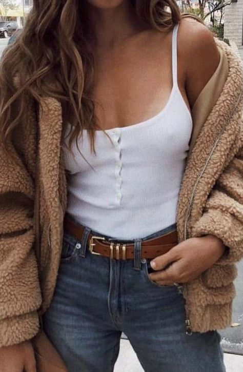 teddy fleece jacket + button rib tank + high waisted denim jeans .