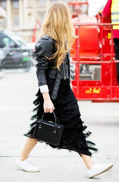 skirt, black skirt, fringes, white sneakers, black leather jacket .