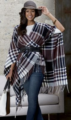 As cozy as a favorite blanket, this belted, fringed poncho wraps .