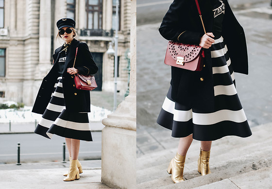 Andreea Birsan - Striped Midi Skirt, Military Cap, Graphic T Shirt .
