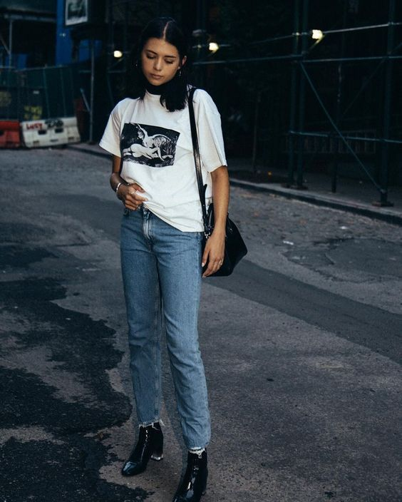 Layer a turtleneck under a graphic t-shirt and jeans for a cool .