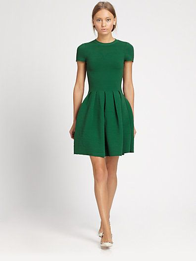 Green dress... Add a hounds tooth jacket and some black suede .