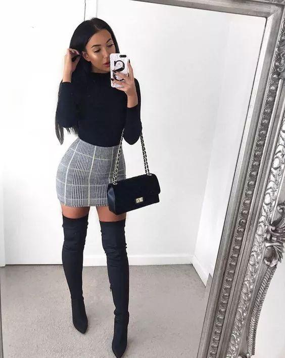 Black mock neck top, grey plain skirt, black thigh high boots .