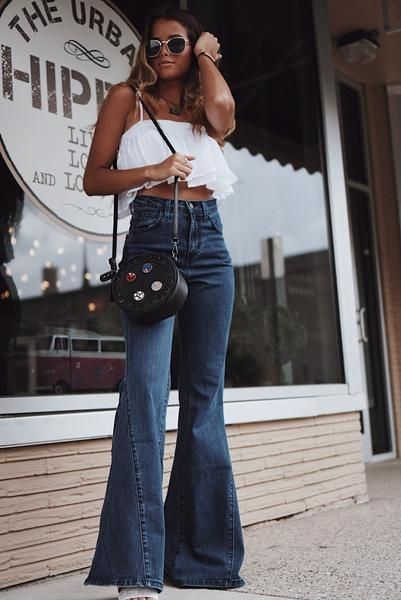 We are throwing it back with these extra wide bell bottom jeans .