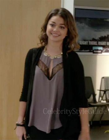 Sarah Hyland as Hailey Dunphee lavender and lace keyhole top .