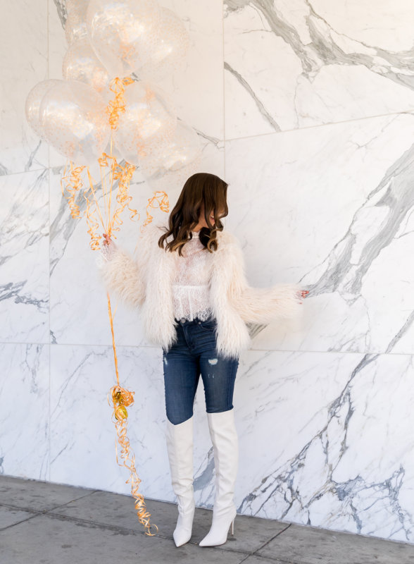 Sydne Style wears bcbg white lace top with faux fur jacket for .