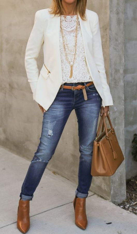 Love the white lace tank under the white blazer with skinny jeans .