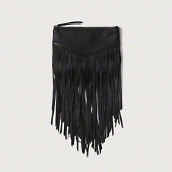 Faux Leather Fringe Wristlet Fringes on the front. Wrist strap can .