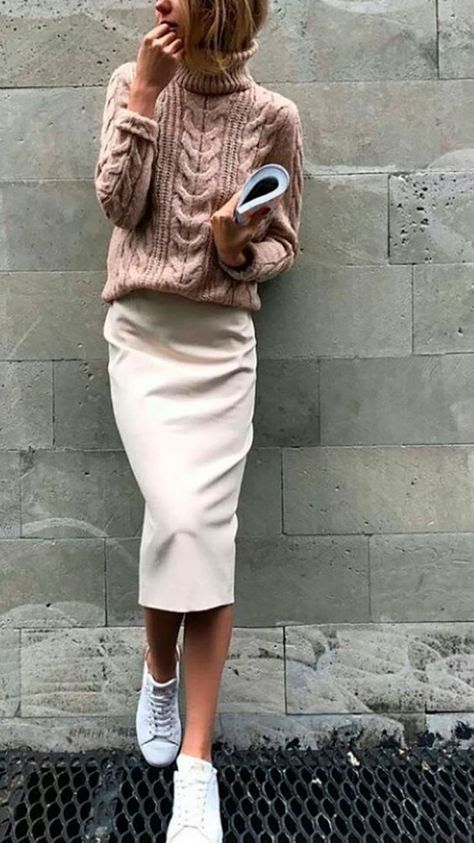 Salmon pink cable knit sweater with khaki pencil skirt and white .