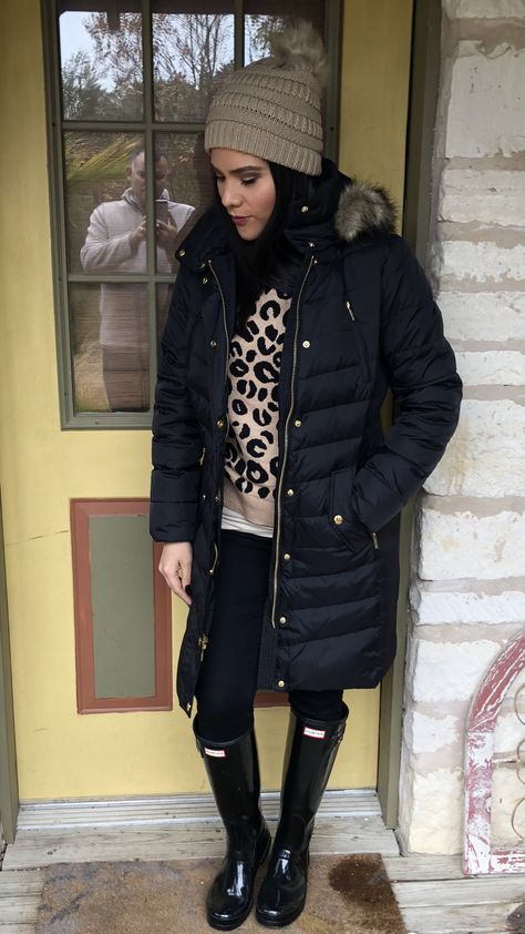 Winter outfit ideas black long puffer jacket fur hood Michael Kors .