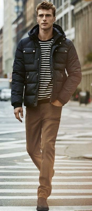 Fall outfit idea with a navy puffer jacket navy white striped long .