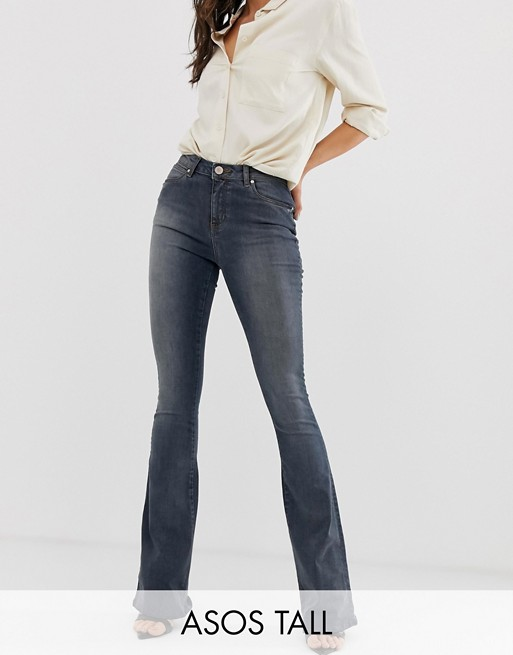 ASOS DESIGN Tall super low rise flare jeans in dark stone wash .