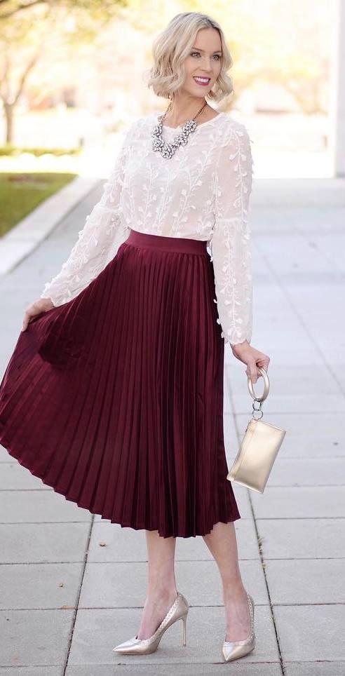 a midi maroon skirt that has already mastered the whole flirty .