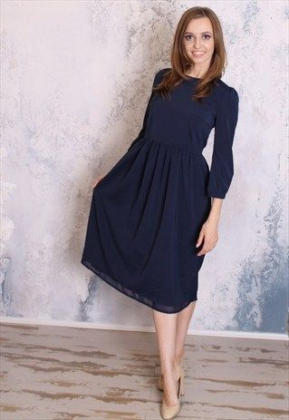 Navy blue midi dress with sleeves coming soon to Mode-sty .