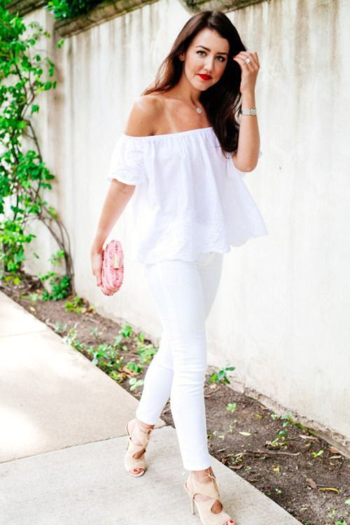 Picture Of white jeans, an off the shoulder top, a pink clutch and .