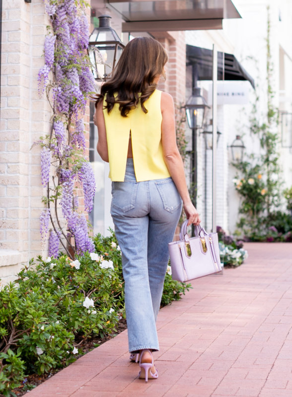 Sydne Style wears bcbg open back sweater for spring outfit ideas .