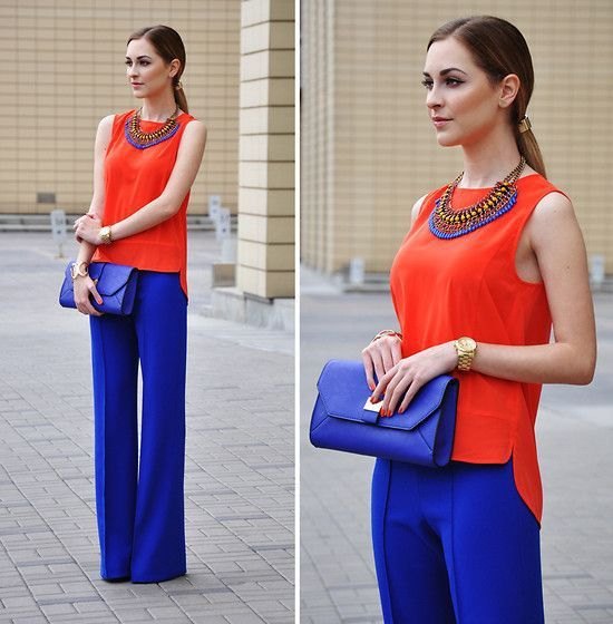 cobalt pants outfit with orange top and cobalt clutch | Colourful .