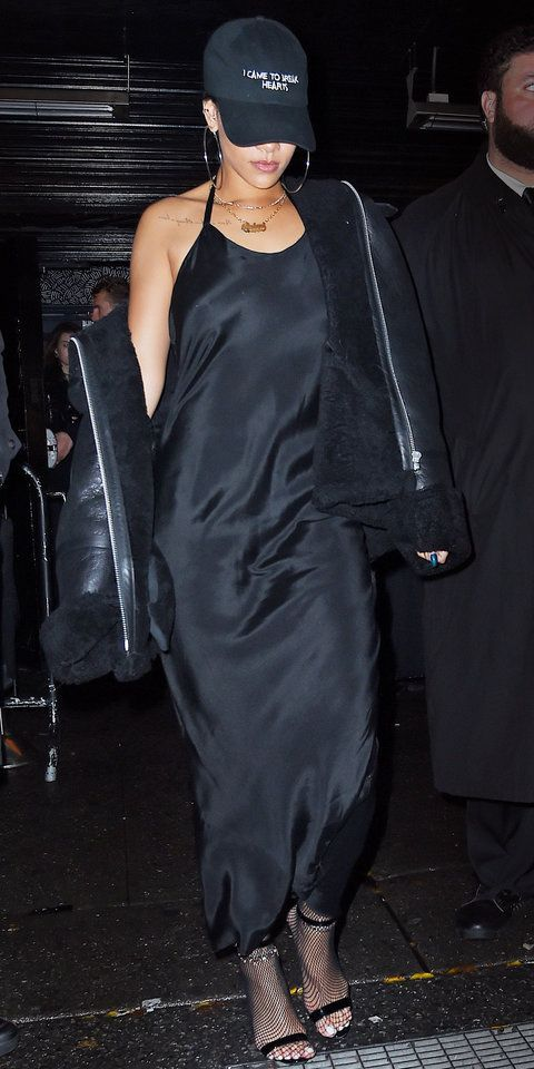 Rihanna wearing all black outfit, feat. a black maxi dress and .