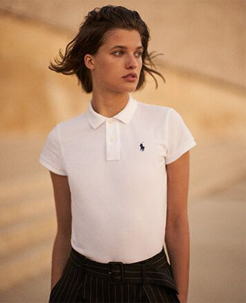 Woman in white Polo shirt with navy Polo Pony at che