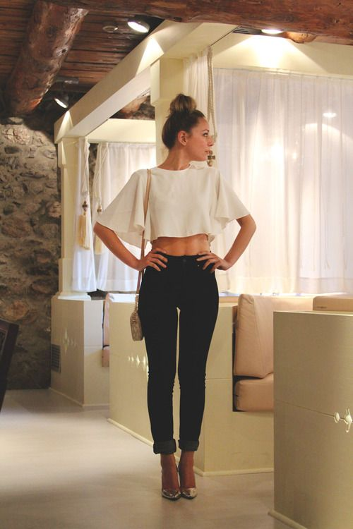 white crop top, black high waisted skinny jeans, over the shoulder .