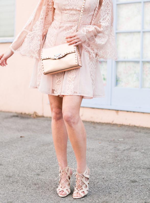 Sydne Style wears la maison talulah pink lace dress for spring .