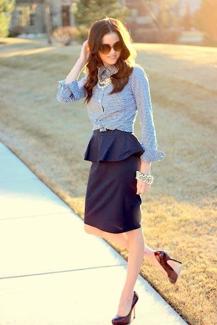 Peplum skirt outfit idea #1. Wear a peplum skirt with a rolled .