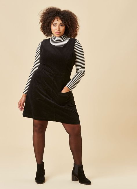 Delightful Daphne! This classic black pinafore dress is a stylish .