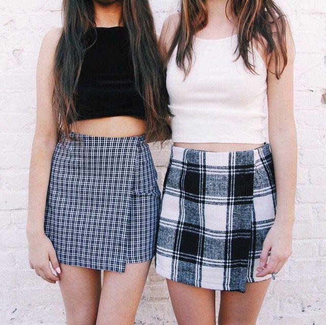 Black crop top + plaid skirt & white crop top + plaid skirt .