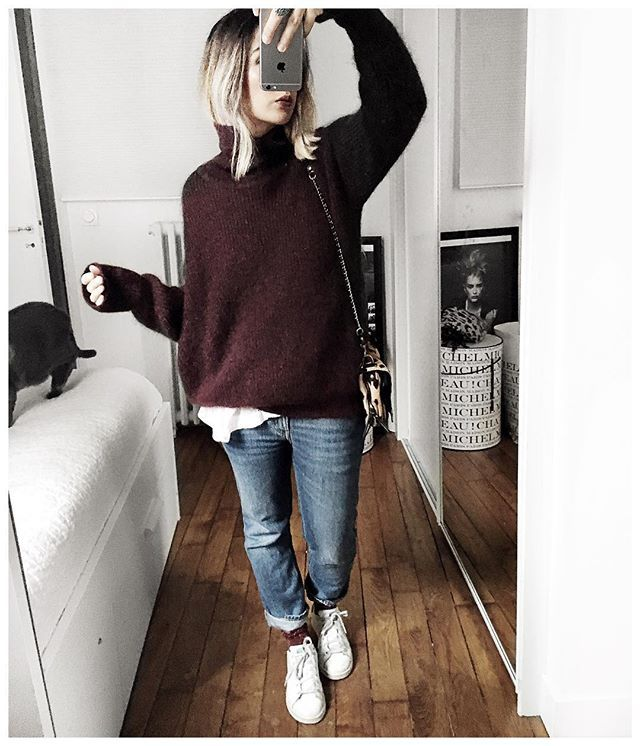 Winter warmth, chic oversized burgundy sweater with relaxed jeans .