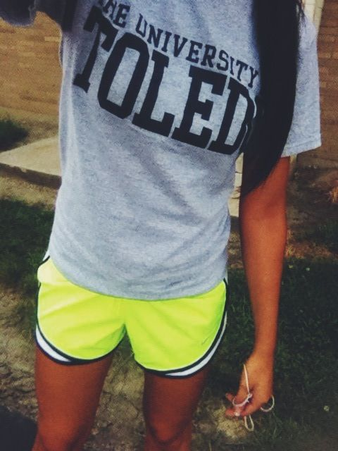 Neon green and navy lined Nike shorts. UT tee . -running | Running .