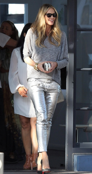 Elle Macpherson all grey with silver pants | Metallic jeans .