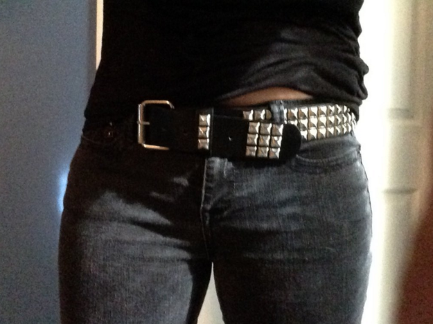 Wearing a studded belt and vehemently denying that you were going .