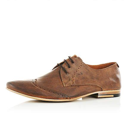 Brown low profile brogues - brogues / loafers - shoes / boots .