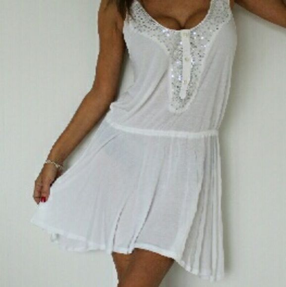 New Free People tunic New never worn. White with sequin at the .
