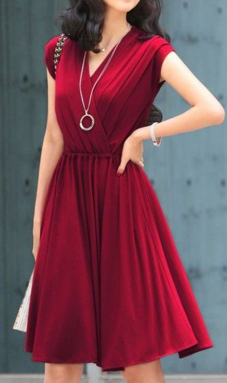 V-neck dress with the perfect amount of accessorizing! | Dark red .