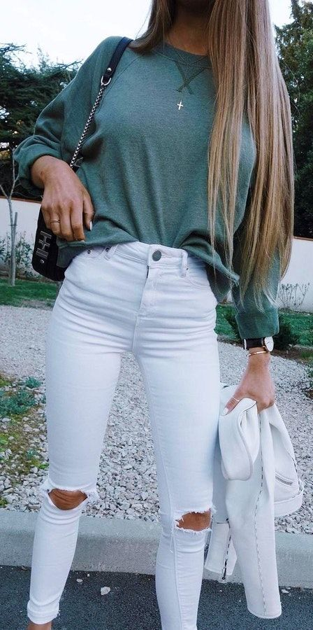 winter #outfits green sweater with white distressed jeans .